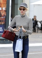 January Jones was almost unrecognizable wearing a gray baseball cap and a pair of shades while running errands.