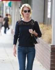 January Jones took a stroll in Beverly Hills wearing a pair of cateye sunnies.
