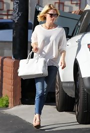 January Jones kept her look casual and cool with an oversized white tee.