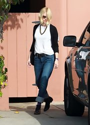 January Jones donned slouchy boyfriend jeans and black leather oxfords.
