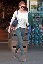 Rosie Huntington-Whiteley was a sight for sore eyes in sage leather skinny jeans and a slouchy cream top.