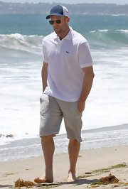 Jason's gray sports shorts kept his look athletic and casual on the beach.