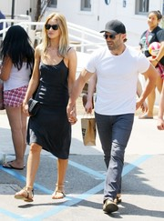 Rosie Huntington-Whiteley showed off her supermodel physique in a little black slip dress while grabbing lunch.