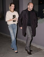 Rosie Huntington-Whiteley contrasted her demure top with grunge-chic Goldsign jeans.