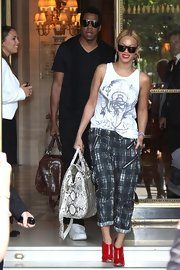 Beyonce Knowles wore ultra-shiny red peep-toe booties while checking out of her hotel in Paris.