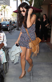 Jenna complemented her fringe messenger bag with matching wedge heels.