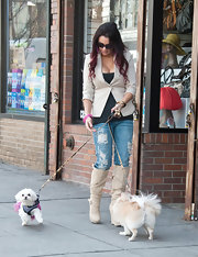 Jenni Farley took her dogs for a walk in ripped up medium wash jeans and cream boots.