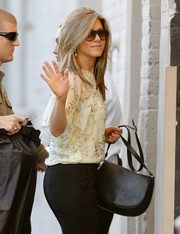 Jennifer Aniston clutched a simple black Celine satchel as she entered the 'Jimmy Kimmel' studio.