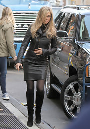 "Jennifer Aniston filmed scenes for her new film ""Wanderlust"" in black suede knee high boots. She paired the slouchy boots with black tights, and a leather jacket and skirt."