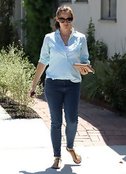 Jennifer got preppy with her pale blue button-down by rolling up the sleeves and tucking in the front.