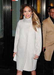Jennifer was the picture of elegance in this sleek cream winter coat out in LA.