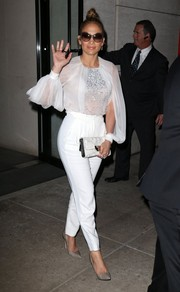 Jennifer Lopez paired her blouse with tapered white slacks, also by Zuhair Murad.