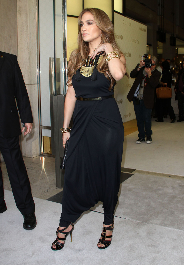 3a691eb644c Jennifer wears a Gucci harem style jumpsuit for the Children s Collection  Launch. She paired this. Jumpsuit. Jennifer Lopez