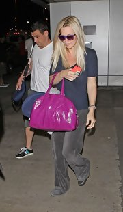 Jenny McCarthy traveled in style carrying a feminine orchid patent Easy tote.