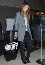 Jessica Alba balanced out her punky jeans with a sleek gray blazer by Reese + Riley.