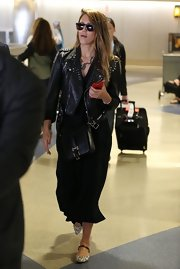 Jessica Alba rocked a studded leather jacket while arriving at LAX.