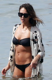Jessica Alba flaunted her beach body in a black bandeau bikini by Eres.