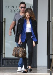 Jessica Alba opted for pointy black d'Orsay flats by Jenni Kayne to complete her outfit.