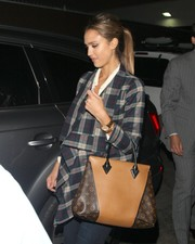 Jessica Alba paired her outfit with the very stylish Louis Vuitton W bag.