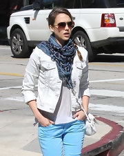Jessica Alba wore this blue patterned scarf with her white jean jacket while out and about.