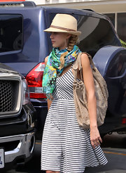 Jessica's casual braid looks great under this simple hat.