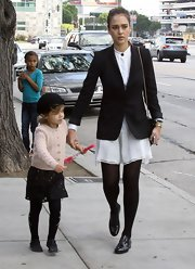 Jessica Alba maintained her school girl style with a pair of black patent brogues.