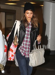 The always-versatile Jessica Alba balanced her biker-chic holiday shopping look with a practical gray leather tote.