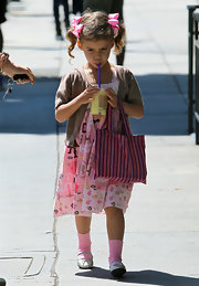 Honor Warren looked absolutely adorable with her curly pigtails tied together with bows.