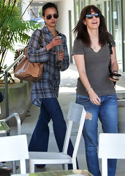 Jessica wore wide-leg flare jeans while out in Brentwood, CA.
