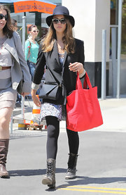 Jessica Alba went shopping in Santa Monica looking comfy in a pair of distressed leather lace up boots.