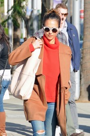 Jessica Alba was spotted shopping in Beverly Hills carrying a white leather shopper bag.