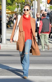 Jessica Alba teamed her turtleneck with on-trend ripped flare jeans.