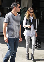 Cash Warren was dressed down in jeans and a striped V-neck tee at the SLS Hotel.