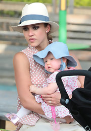 Jessica looked cute and sun-safe in her white fedora with a blue feathered band.