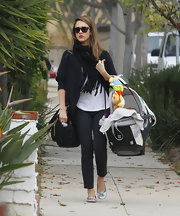 Jessica Alba rocked a pair of unexpected polka dot slacks on her way to Mommy & Me class.