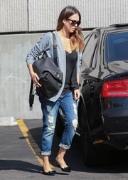 A stylish black leather backpack topped off Jessica Alba's casual ensemble.