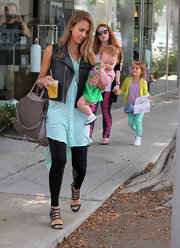 Jessica Alba kept her trendy tunic and leather vest a little bit edgy with these cage-inspired sandals.