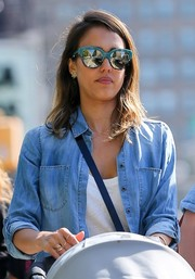 Jessica Alba took a stroll in New York City wearing a cool pair of blue-rimmed sunnies by Stella McCartney.