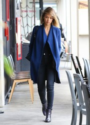 Jessica Alba completed her attire with a pair of purple snakeskin ankle boots.