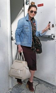 Jessica Biel stopped by Au Fudge Restaurant wearing a denim jacket with a floral scarf and a burgundy dress.
