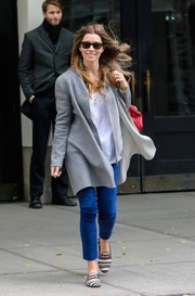 Jessica Biel stepped out in NYC on a windy day wearing a gray coat by Autumn Cashmere.