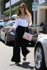 Jessica Biel styled her look with a pink chain-strap bag by Louis Vuitton.