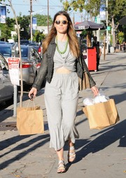 Jessica Biel showed a bit of abs in a gray cutout dress while strolling in Beverly Hills.