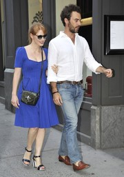 Jessica Chastain teamed her dress with chunky-heeled black-and-white sandals.