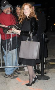 Jessica Chastain arrived for her 'Jon Stewart' appearance wearing a black wool coat with shiny sleeves.