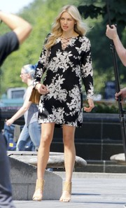 Jessica Hart looked spring-chic in a floral mini dress with a lace-up neckline while doing a photo shoot.