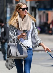 Jessica Hart kept the sun out with a pair of designer shield shades while out for a stroll in New York City.