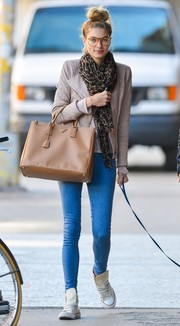 Jessica Hart was spotted out in New York City carrying a stylish tan Prada tote.