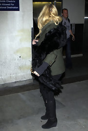 Jessica Simpson was a stylish jet setter in black wedge boots.