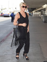 Jessica Simpson matched her jumpsuit with sexy black strappy sandals.